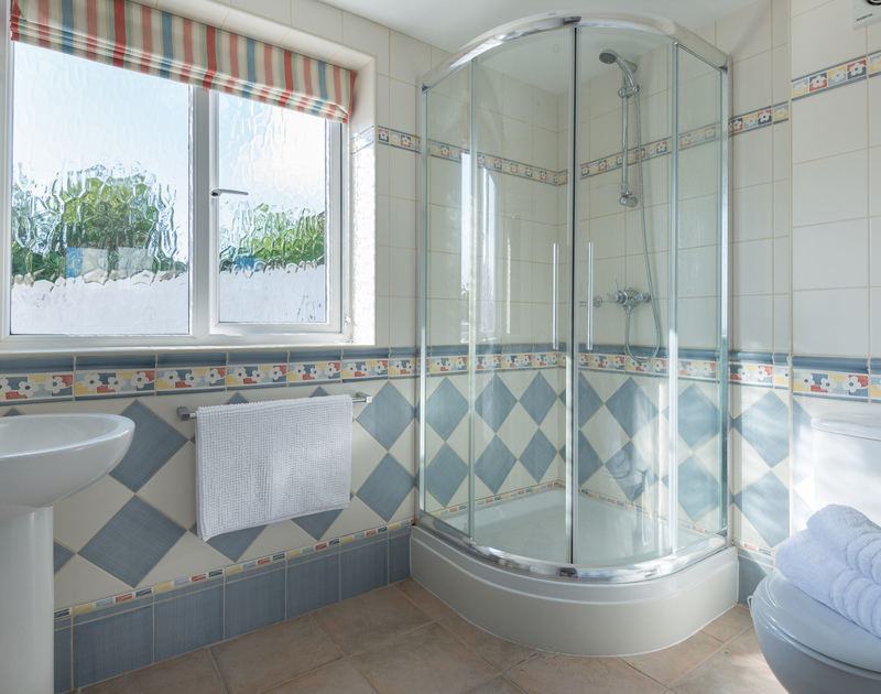 The twin bedroom's ensuite shower room at Polmorla, with attractive colourful tiled walls