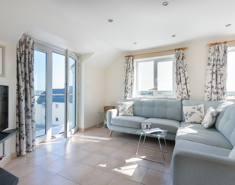 Open the balcony doors and enjoy the sea airs in Polmorla's first floor living area