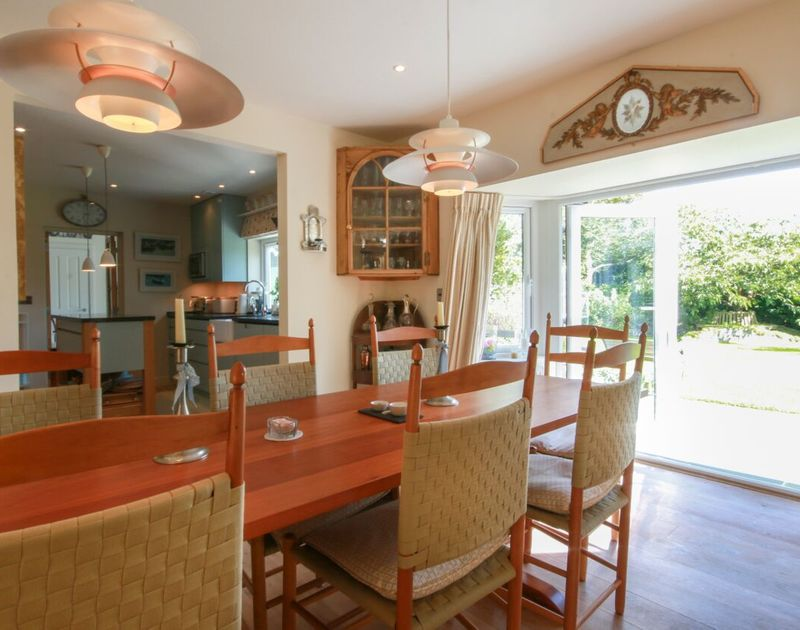 Enjoy family meals in the formal dining room at Cannon Heath then open the bi-fold doors out onto the garden