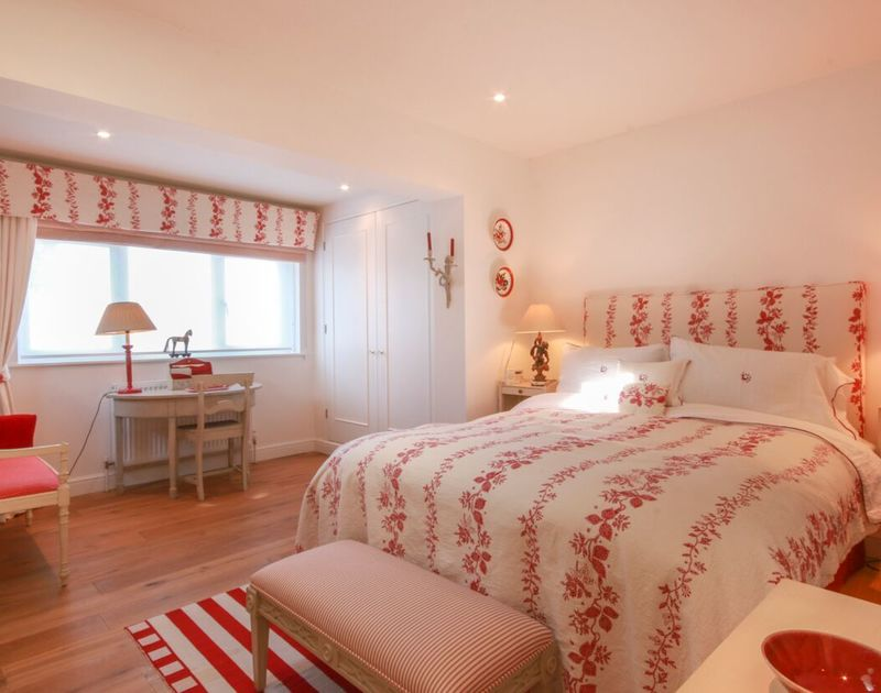 The double bedroom on the ground floor at Cannon Heath has use of a shared family bathroom.