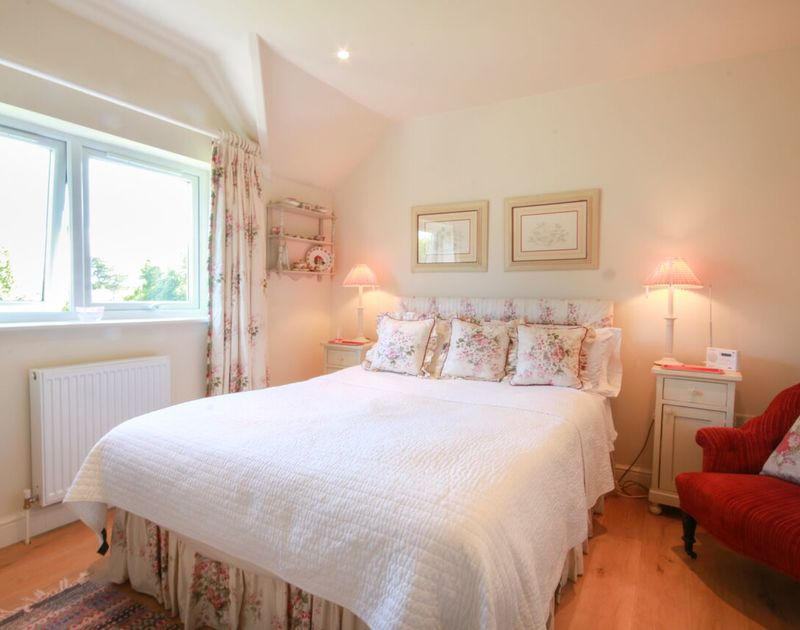One of three first floor bedrooms at Cannon Heath - this pretty double bedroom has shared use of the family bathroom