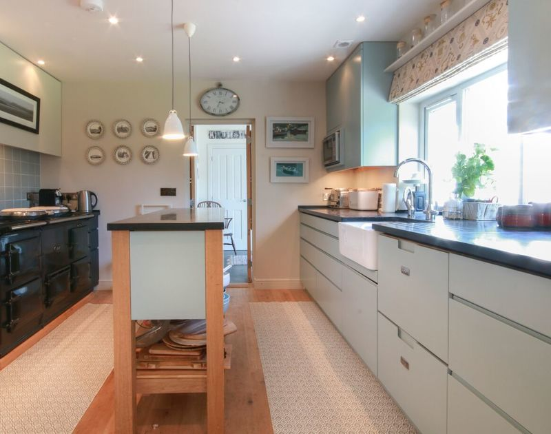 Prepare lavish family meals in the stylish kitchen at Cannon Heath, with its double electric AGA