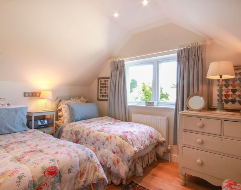 The first floor twin bedroom at Cannon Heath in Rock, Cornwall has shared use of the family bathroom