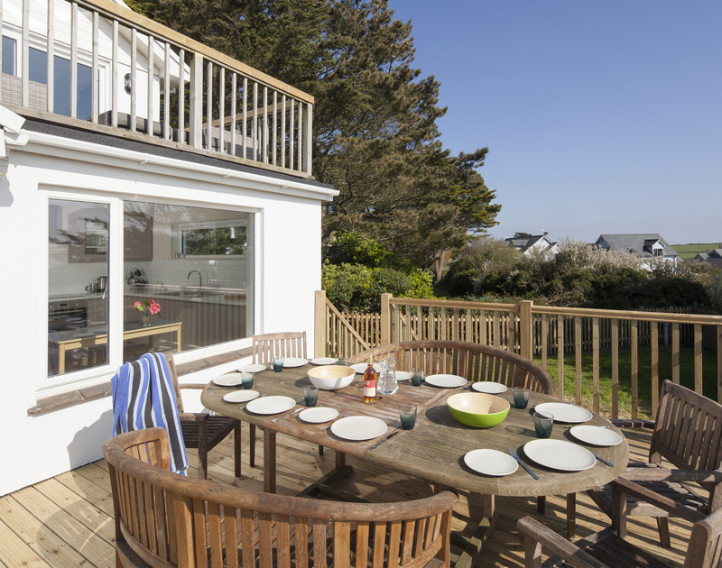 The pretty and practical wooden terrace is perfect for alfresco meals with the family on balmy Cornish days at Brae Heights.