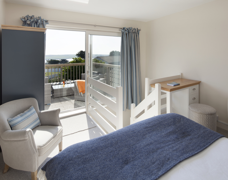 The french windows and balcony with sea views over the Camel Estuary from the first floor bedroom at Brae Heights, a newly refurbished holiday home in a fantastic location above Daymer Bay and Greenaway beach.