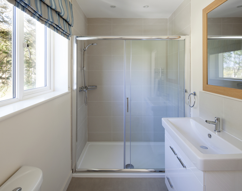 The king size bedroom on the first floor's brand new ensuite shower room at Brae Heights.