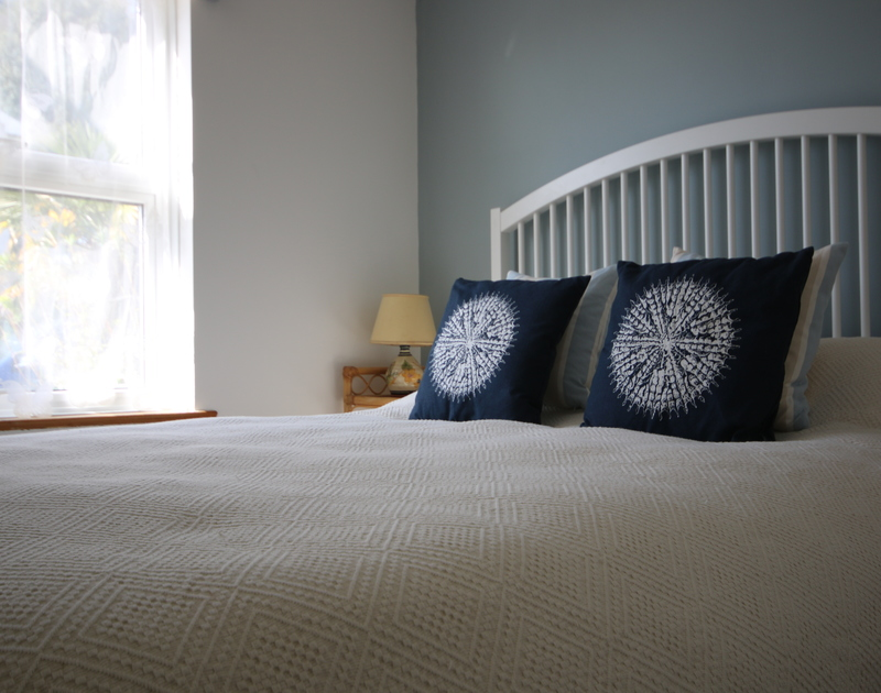 Snuggle up with a good book in the double bedroom of Slipway 21, a conveniently located holiday cottage in Rock