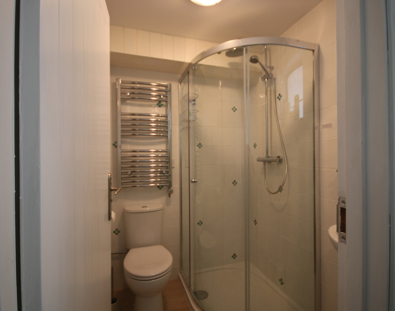 A very useful ground floor shower room at Slipway 21, with heated towel rail and sink.