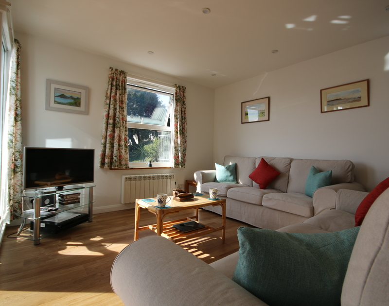 The sitting room with two sofas, coffee table and TV in the sitting room of Slipway 21, holiday let in Rock