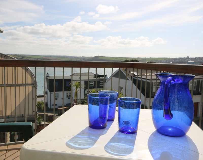 Enjoy a drink on the balcony of Slipway 21 and gaze out at the view of the river and Padstow