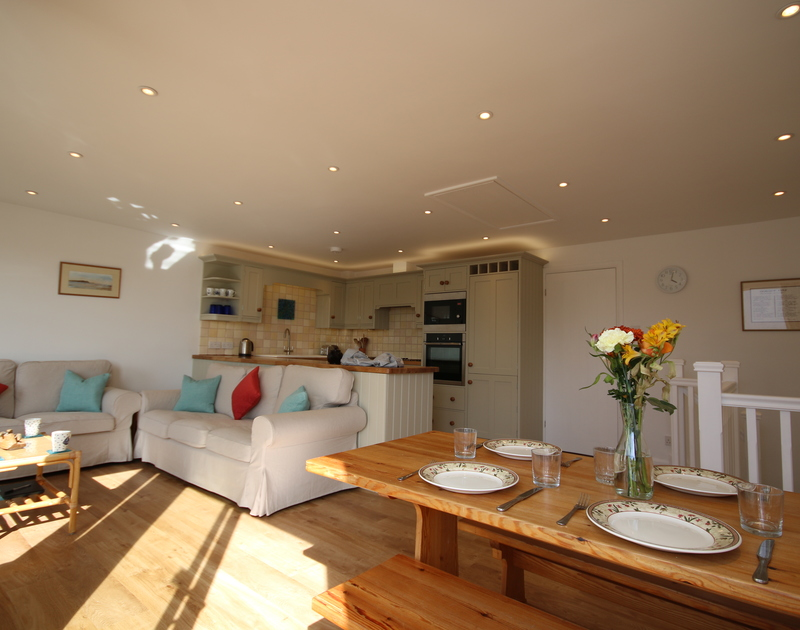 The open plan kitchen/dining/sitting room of Slipway 21, a homely holiday rental in Rock, Cornwall
