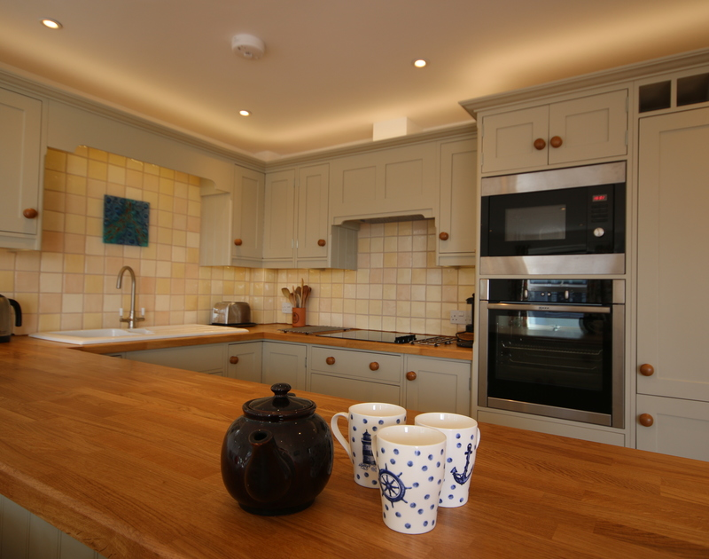 The smart galley style kitchen at Slipway 21 with attractive wood work surface