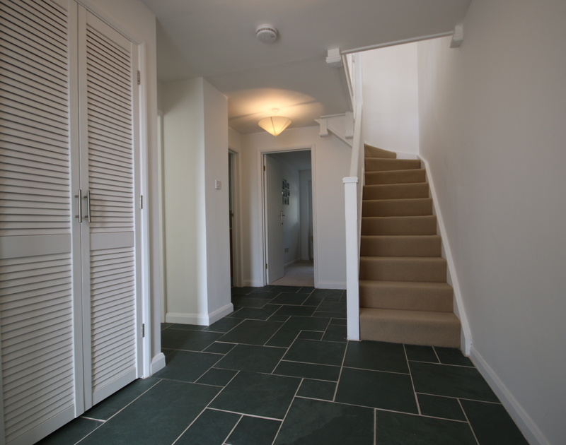 The hallway of Slipway 21, leading to the stairs, snug room, shower and utility