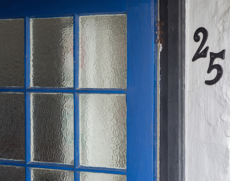 The nautical sea blue door at The Bakehouse in Port Isaac