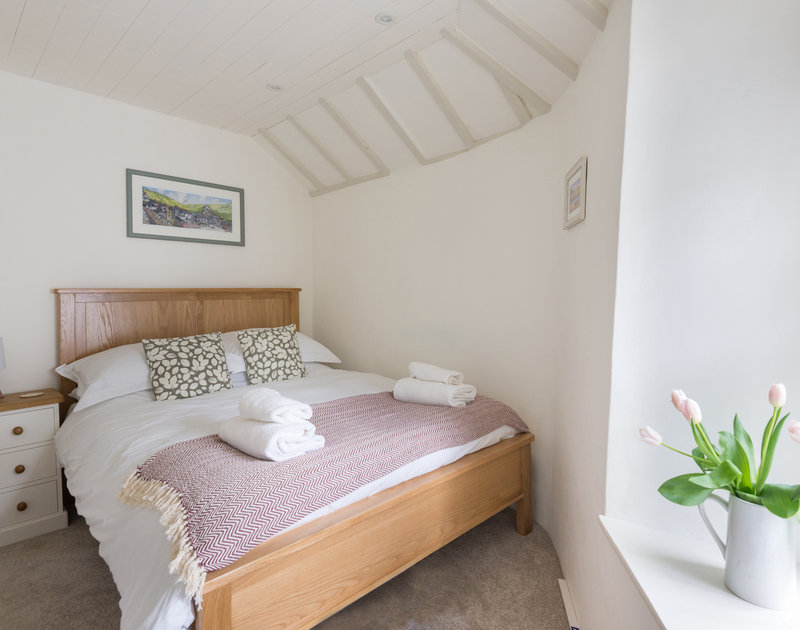 Awaken to the sounds of the sea and the gulls in the double bedroom at The Bakehouse in Port Isaac