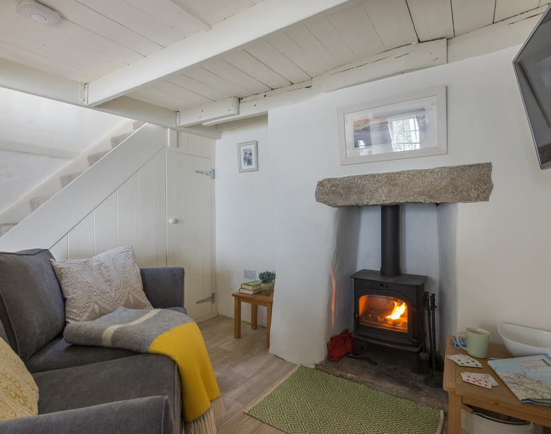 Relax by the fire and read, play games or watch a movie at The Bakehouse in Port Isaac