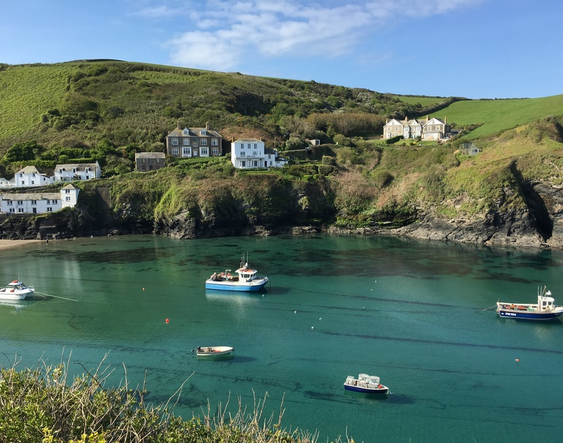 Enjoy exploring Port Isaac's beautiful fishing harbour with its crystal blue waters and scening coastal paths