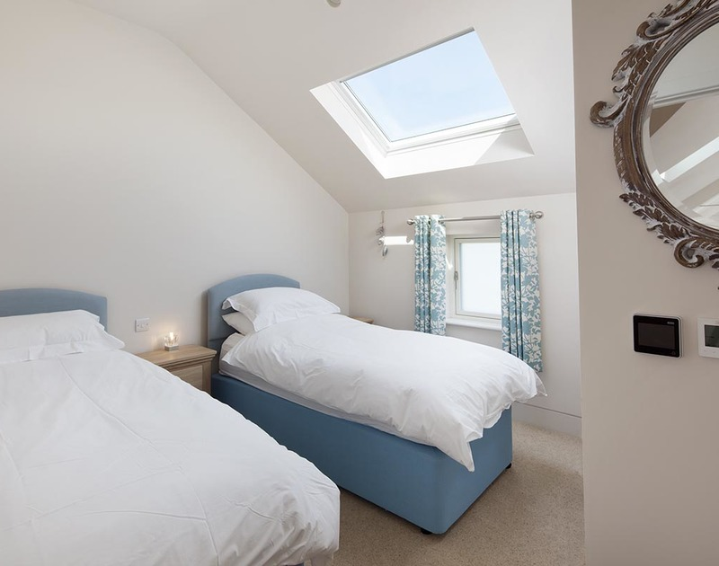 Bright, twin bedroom with skylight in luxury self catering holiday house Mordros between Daymer Bay and Greenaway,  North Cornwall.