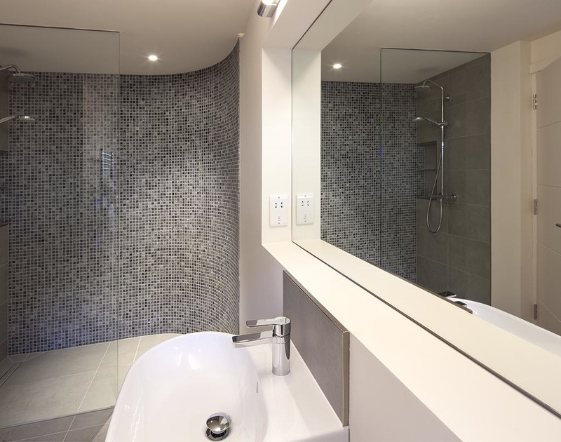 Mosaic tiling in the beautifully decorated ensuite of the lower ground floor, king size bedroom at  Mordros.