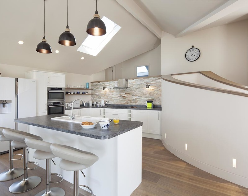 The stylish kitchen and breakfast bar at luxury self catering holiday property Mordros, within walking distance of both Greenaway and Daymer Bay in North Cornwall.