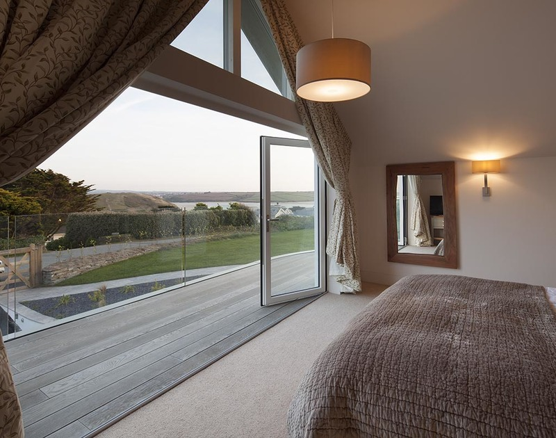Throw open the bi-fold doors and step out onto the wooden decked balcony where lovely views over the Camel Estuary and Brea Hill can be seen from the master bedroom suite at Mordros.