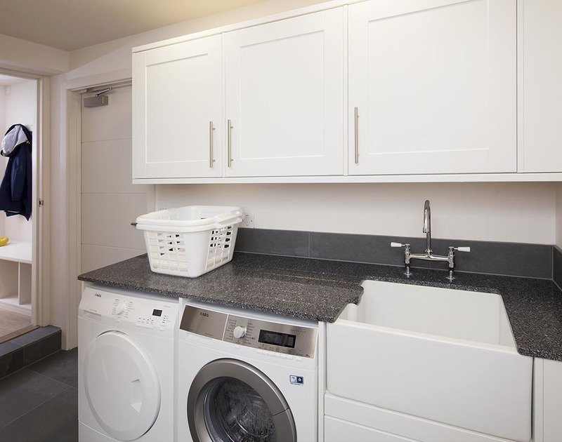 A useful utility room at Mordros, a self catering holiday property in walking distance of the beautiful beaches of Greenaway and Daymer Bay in North Cornwall.