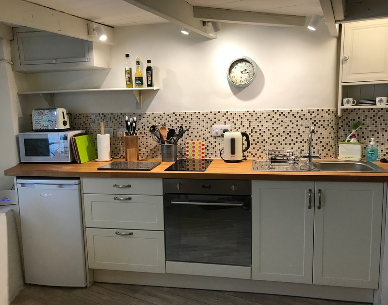 The compact and practical kitchen in The Bakehouse, Port Isaac, North Cornwall.
