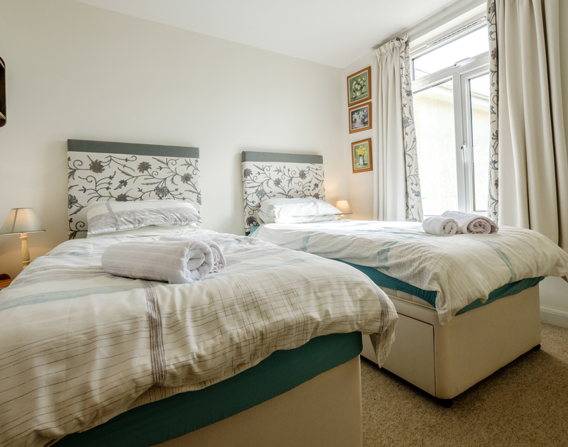Bedroom two on the ground floor of Tresawl, Epphaven near Polzeath with zip and link beds.