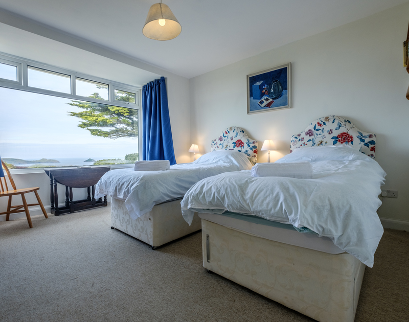 The master bedroom with stunning sea views and super king zip and link beds, Epphaven, Cornwall.