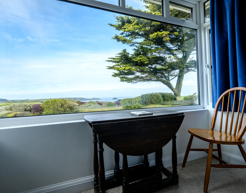 A perfectly placed table and chair to take in the terrific rural and sea views over Epphaven at Tresawl.