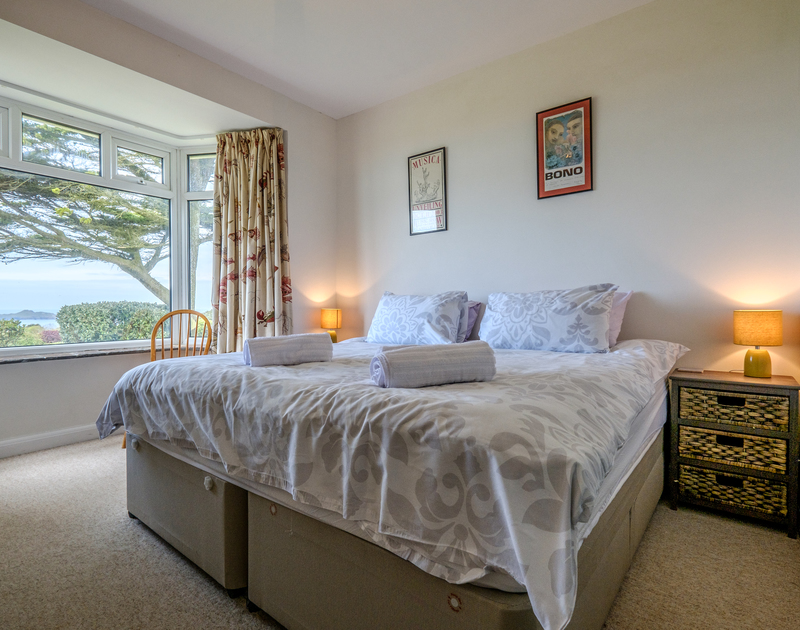 Zip and link beds in a room with a view over Epphaven, near Lundy Bay and Polzeath in Cornwall.