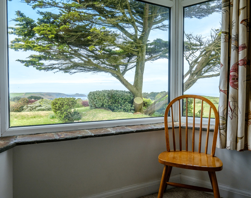 A pretty slate silled window with gorgeous views down the garden and out to sea at Tresawl, Epphaven, North Cornwall.