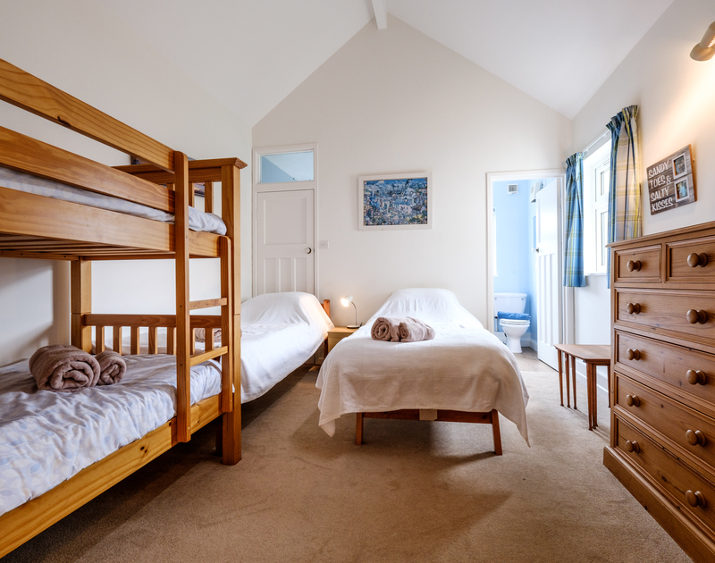 The cheerful bunk bedroom with ensuite bathroom in Tresawl, Epphaven near Polzeath and Lundy Bay, Cornwall.