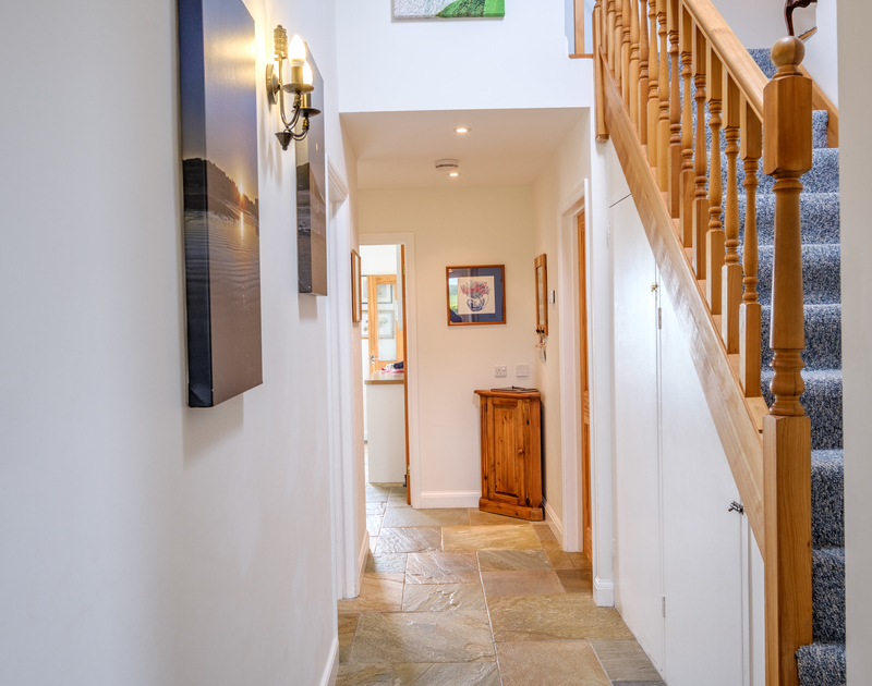 The bright, light filled hallway at Tresawl in Epphaven.