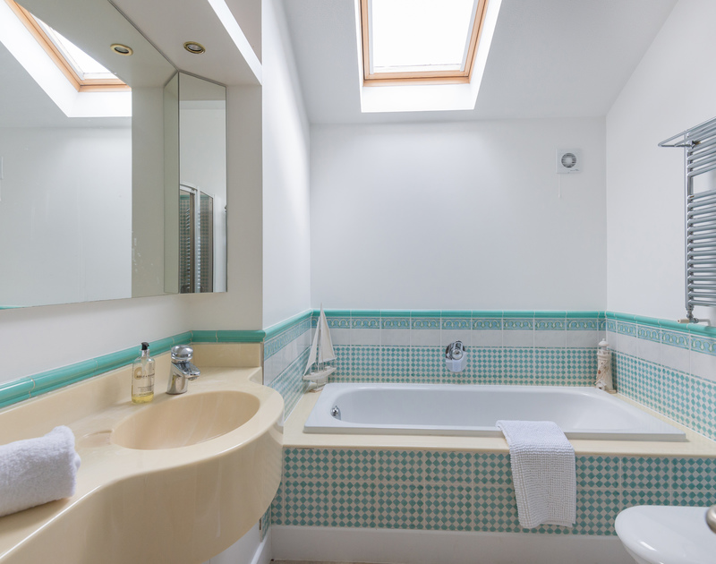 The bright, family bathroom at Penny Liggan with a separate shower.