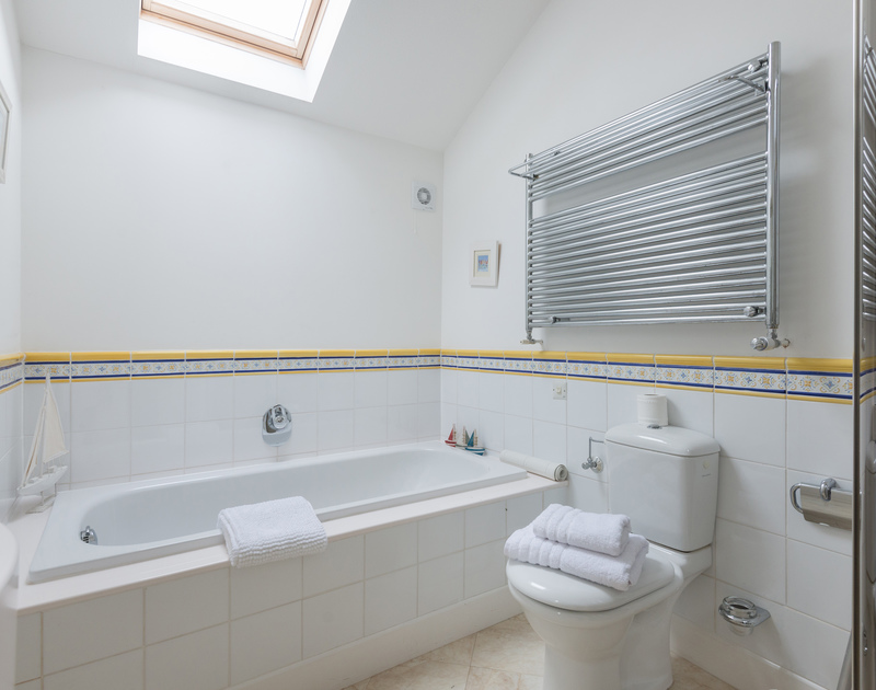 One of the bathrooms with a separate shower and skylight at Penny Liggan in Rock.