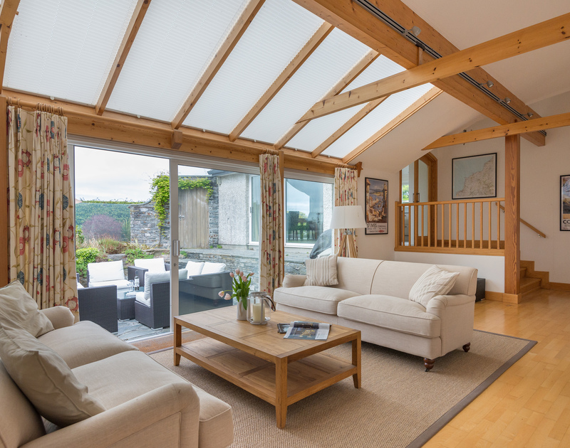 Plenty of room for relaxing in the sitting room at Penny Liggan, inside on the comfy sofas or outside on the sheltered patio on balmy days in Rock, North Cornwall.