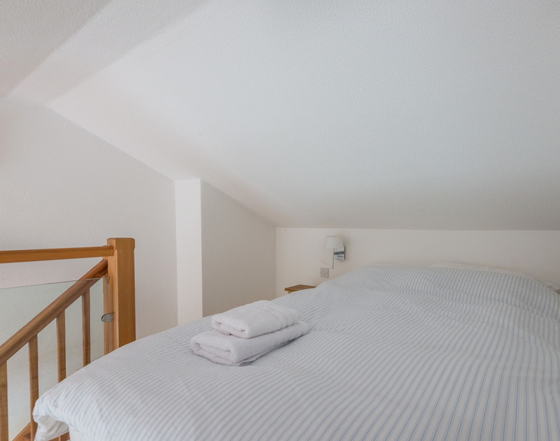 A double bedroom under the eaves on the mezzanine level with its own ensuite at Penny Liggan.