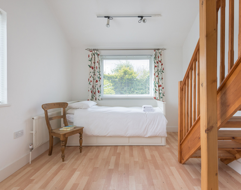 The single bed below the mezzanine level double bedroom with an ensuite at Penny Liggan in Rock.