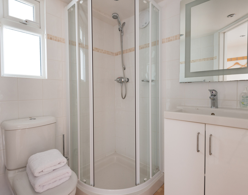 The triple bedroom/mezzanine rooms ensuite shower room at self catering holiday property Penny Liggan in Rock.