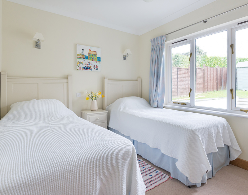 Spacious ground floor twin bedroom at Ragleighs, a stylish, luxurious holiday house to rent close to Daymer Bay, Cornwall.