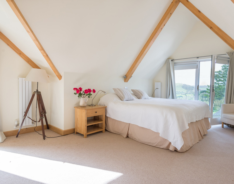 Just part of the top floor master bedroom, which has views inland and out towards the estuary at Ragleighs, a luxury self catering,holiday house close to Daymer Bay in Cornwall.