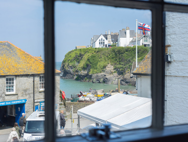 Pretty views from the sash window in the master bedroom of the fishsellers, harbour and sea from perfectly placed Morleys Cottage.