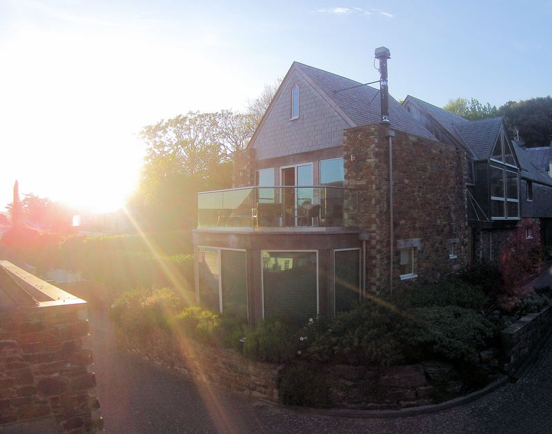 Sunset photo of Gull Rock 4, a luxury self-catering holiday home situated within touching distance of the slipway, Sailing Club, Mariners pub and restaurant and beach at Rock, Cornwall