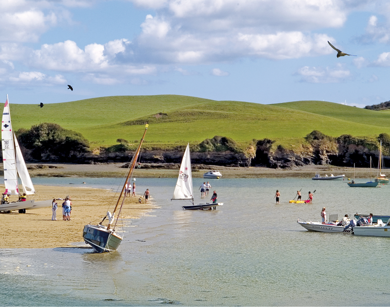 A summer day at Porthilly Cove, Rock, Cornwall, being enjoyed by families and boaters of every kind. Credit to Paul Kikby Emotive Pictures