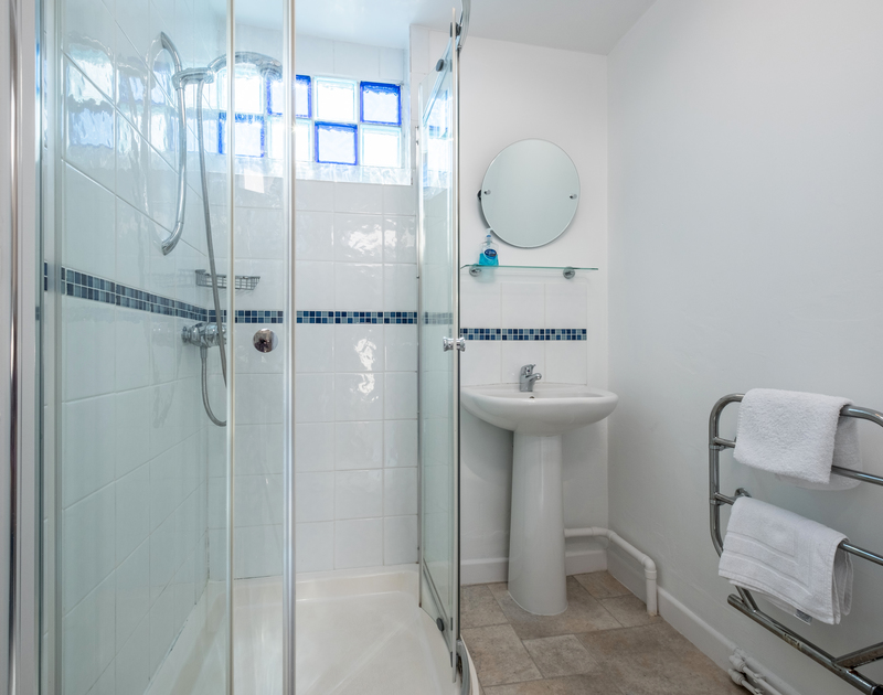 The ground floor shower room off the utility at The Moorings is perfect for washing off the beach, before heading indoors