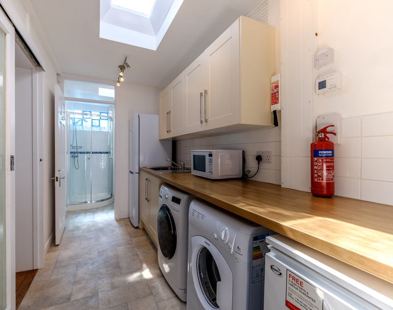A convenient and large utility room off the kitchen at The Morrings in Rock, is perfect for storing beach clutter