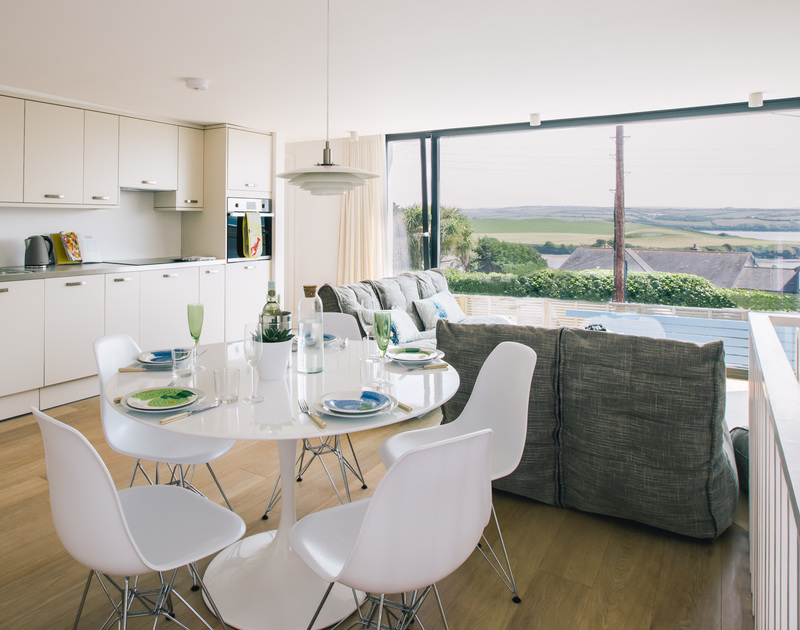 The stylish modern interior at White Star has an open plan living space with stunning estuary views