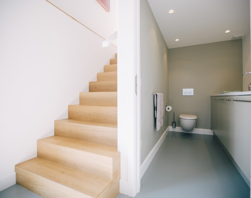 A useful utility room and W.C. on the ground floor at White Star is linked via a stylish oak staircase to the open plan living space