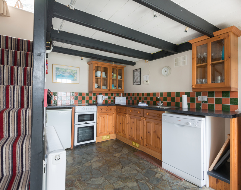 Practical and welcoming kitchen at Northcliffe Garden Flat, with characterful ceiling beams